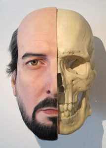 Half man half skull suclpture by Sam Jinks