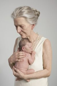 Old woman and baby